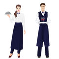 Young beautiful waitress and handsome waiter at restaurant . Royalty Free Stock Photo