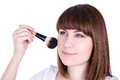Young beautiful woman applying make up with brush isolated on wh white background Stock Image
