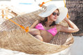 Young beautiful woman on the beach relaxing hammock Stock Images