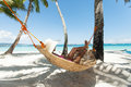 Young beautiful woman on the beach relaxing hammock Royalty Free Stock Image