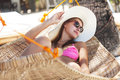 Young beautiful woman on the beach relaxing hammock Royalty Free Stock Photos