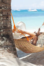 Young beautiful woman on the beach relaxing hammock Royalty Free Stock Photo