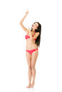 Young beautiful woman in bikini pointing on copy space isolated white background Stock Images