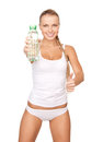 Young beautiful woman with bottle of water picture Royalty Free Stock Photography