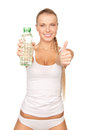 Young beautiful woman with bottle of water picture Stock Image
