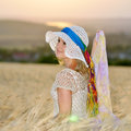 Young beautiful woman on cereal field in summer Royalty Free Stock Photo