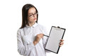 Young beautiful woman with a clipboard in his hands. Long-haired brunette in glasses and a white shirt. The woman points to the cl Royalty Free Stock Photo
