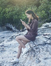 Young beautiful woman connecting people by smart phone on sea si Royalty Free Stock Photo