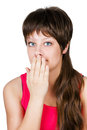 Young beautiful woman covering her mouth with her hand. isolated