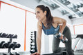 Young beautiful woman doing exercises with dumbbell in gym. Royalty Free Stock Photo