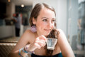 Young beautiful woman drinking coffee at the bar Stock Photos