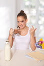 Young beautiful woman drinking glass hot drink sunshine Royalty Free Stock Image