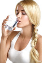 Young beautiful woman drinking a glass of water on white Royalty Free Stock Photos
