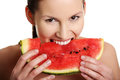 Young beautiful woman is eating watermelon. Royalty Free Stock Photography