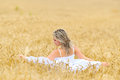 Young beautiful woman on field in summer golden Stock Images