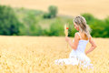 Young beautiful woman on field in summer golden Royalty Free Stock Image