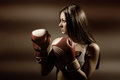 Young beautiful woman during fitness and boxing a dark background Royalty Free Stock Photos