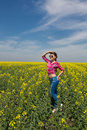 Young beautiful woman in flowering field in summer outdoors close portrait of on green grass the Stock Images