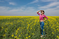 Young beautiful woman in flowering field in summer outdoors close portrait of on green grass the Royalty Free Stock Photos