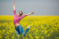 Young beautiful woman in flowering field in summer outdoors close portrait of on green grass the Royalty Free Stock Photo