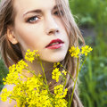 Young beautiful woman with flowers Royalty Free Stock Photography