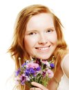 Young beautiful woman with flowers beauty face of the girl on white background Stock Photography