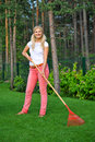 Young beautiful woman gardenind with rakes Royalty Free Stock Photography
