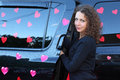Young beautiful woman gets black wet offroader stickers hearts pink wedding Royalty Free Stock Images