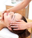 Young beautiful woman getting facial treatment Stock Images
