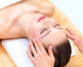 Young beautiful woman getting facial treatment Royalty Free Stock Images