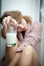 Young beautiful woman with a glass of fresh milk. Royalty Free Stock Images