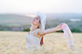 Young beautiful woman on golden cereal field in summer Royalty Free Stock Photo