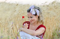 Young beautiful woman on golden cereal field in summer smiling Royalty Free Stock Photography