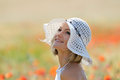 Young beautiful woman on golden wheat field Royalty Free Stock Photo