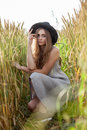 Young beautiful woman in golden wheat field Royalty Free Stock Photo