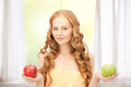 Young beautiful woman with green and red apples Royalty Free Stock Photo