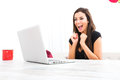 Young beautiful woman happily using a laptop at home being cheerful while computer Royalty Free Stock Image