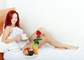 Young beautiful woman having breakfast in bed room for your text Stock Image