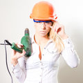 Young beautiful woman with helmet drill and glasses looking at camera blonde on white background Stock Photography