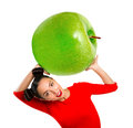 Young beautiful woman holding apple Royalty Free Stock Photo