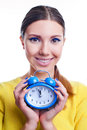Young beautiful woman holding big and small clocks Royalty Free Stock Photo