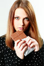 Young beautiful woman holding chocolate isolated on a white Stock Image