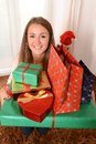 Young beautiful woman holding christmas presents lots of Stock Photo