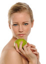 Young Beautiful Woman holding a green apple Royalty Free Stock Photos
