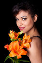 Young Beautiful Woman Holding Lily Flowers Royalty Free Stock Photography