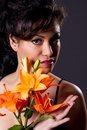 Young Beautiful Woman Holding Lily Flowers Royalty Free Stock Photos