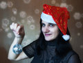 Young beautiful woman holding a mirror ball in christmas cap Royalty Free Stock Photos