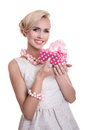 Sweet blonde woman holding small gift box with ribbon
