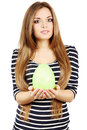 Young beautiful woman holds green egg Royalty Free Stock Image