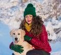 Young beautiful woman hugging her golden retriever dog